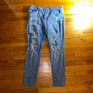 Refuge brand light wash jean with rips
